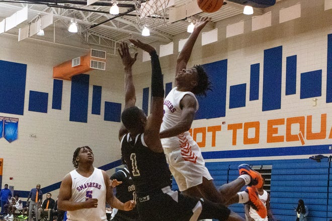 Johnson's Emondre Bowles drives the lane on Windsor Forest's D'Ante Bass in the Knights' win last season. [BEN BRENGMAN/SAVANNAHNOW.COM FILE PHOTO]