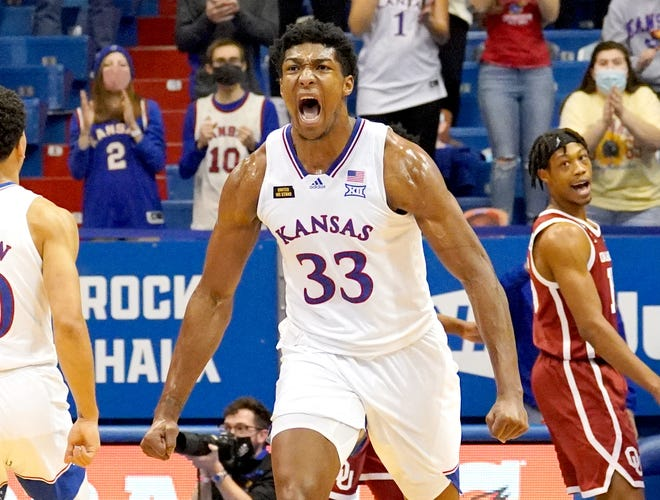 Kansas basketball junior forward David McCormack celebrates after scoring a basket late in the second half of the No. 6-ranked Jayhawks' contest against Oklahoma at Allen Fieldhouse in Lawrence. McCormack scored a game-high 17 points in KU's 63-59 victory.