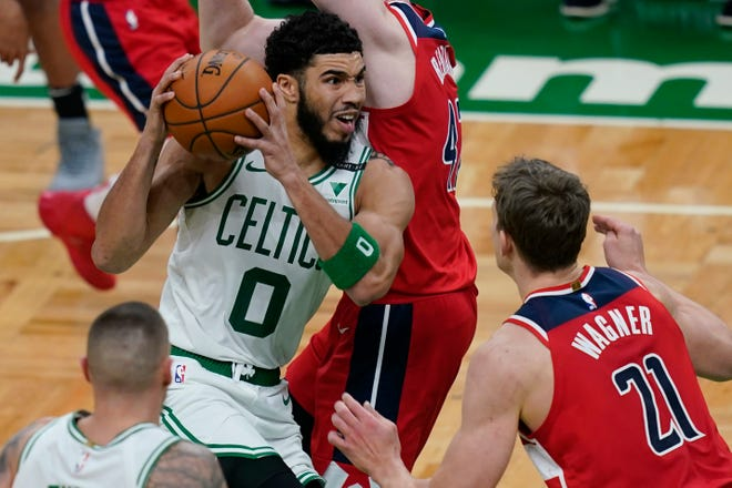 Boston's Jayson Tatum was one of a handful of players unavailable for Sunday's game against Miami due to COVID-19 protocols, prompting the NBA to postpone the game.