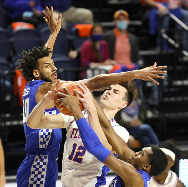 Florida forward Colin Castleton, former Father Lopez standout, had a rough time Saturday night at Kentucky. Averaging 11 points per game this season, Castleton only scored six in the Gators' loss.