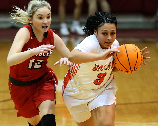 Stigler's Gentry Powell pressures Roland's Makya Perryman as she pushes the ball up court in the first quarter, Saturday, Jan. 9, during the Armstrong Bank Sequoyah County Classic at Muldrow.