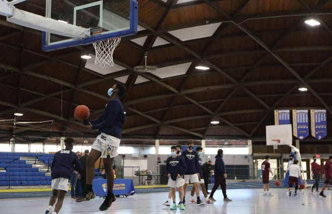 Lexington boys basketball warms up before beating Belmont, 80-78, in the Fieldhouse Jan. 9.