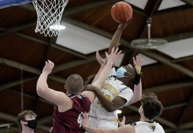 exington junior John Mathurin goes up and scores against Belmont Jan. 9.