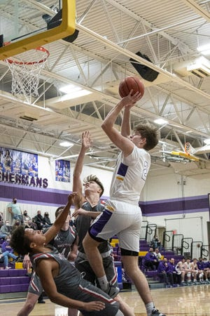 Unioto's Cameron DeBord shoots over Westfall's Casey Cline and Blaec Bugher during Saturday night's game at Unioto High School. Unioto defeated Westfall 52-23.