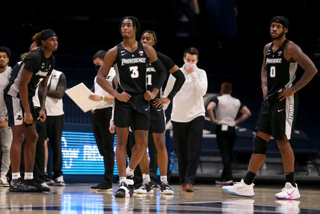 Friars David Duke (3) and Nate Watson react after Xavier connected on the game-winning basket Sunday.