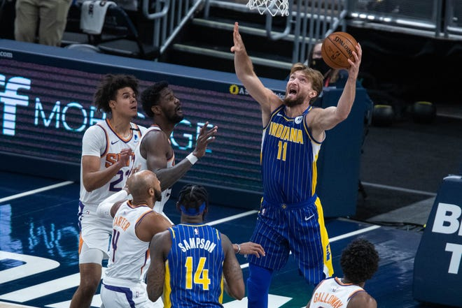 Jan 9, 2021; Indianapolis, Indiana, USA; Indiana Pacers forward Domantas Sabonis (11) shoots the ball in the second quarter against the Phoenix Suns at Bankers Life Fieldhouse.