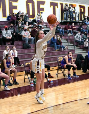 Berne Union sophomore Baylee Mirgon shoots a 3-pointer during a game last week. On Saturday, Berne Union connected on a school-record 15 3-pointers against rival Fairfield Christian Academy.