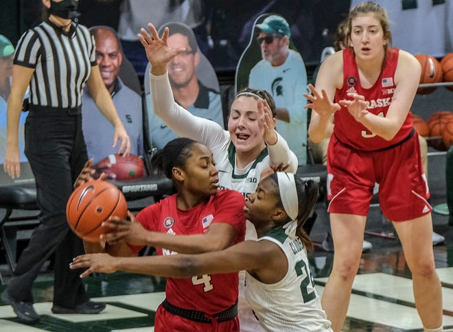 Nebraska's Sam Haiby (4) is double teamed by MSU's Kendall Bostic (44) and Nia Clouden (24) in a hard fought match-up at the Breslin Center Sunday, Jan. 10, 2021. MSU lost 68-64.
