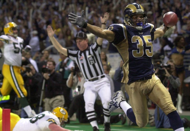 St. Louis Rams defensive back Aeneas Williams scores a touchdown after picking off pass thrown by Green Bay Packers quarterback Brett Favre during the fourth quarter of their game Sunday, January 20, 2002 at the Dome at America's Center in St. Louis, Mo
