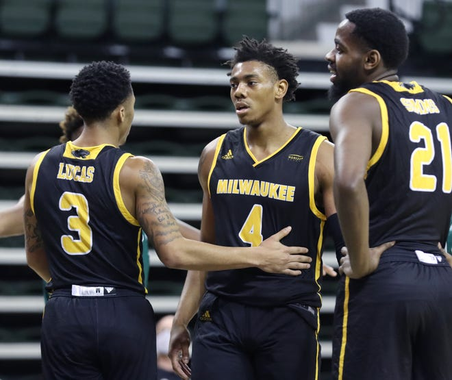 Guard DeAndre Gholston (4), shown in a previous game for UWM, had 16 points Friday night to lead the Panthers in their loss to Purdue Fort Wayne.