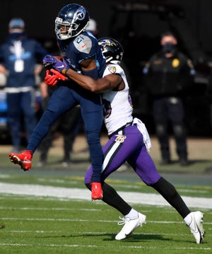 Tennessee Titans cornerback Malcolm Butler (21) pulls in an interception during the Tennessee Titans game against the Baltimore Ravens in Nashville on January 10, 2021.