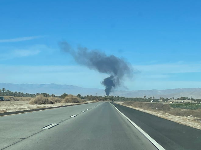 Smoke from an Indio recycling facility is visible from the Highway 86 Expressway in Thermal Sunday, Jan. 10, 2021.