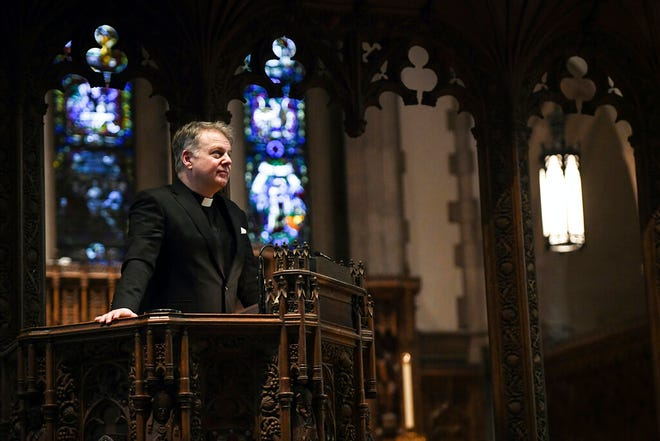 The Rev. Jonathon Jensen stands for a portrait in the pulpit at Calvary Episcopal Church in Pittsburgh on Wednesday, Dec. 30, 2020. (Kristina Serafini/Pittsburgh Tribune-Review via AP)