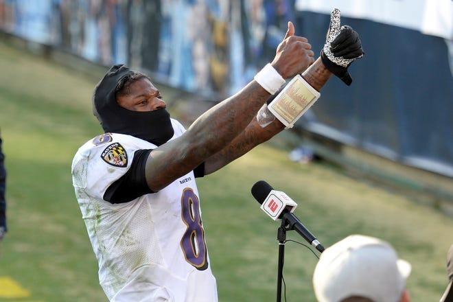 Baltimore Ravens quarterback Lamar Jackson celebrates after the Ravens beat the Tennessee Titans in an NFL wild-card playoff football game Sunday, Jan. 10, 2021, in Nashville, Tenn. (AP Photo/Mark Zaleski)