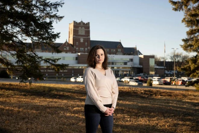 Nurse Kristen Cline is shown outside the VA hospital in Sioux Falls, where she worked in the ICU during the pandemic.