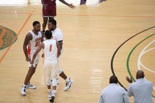 Florida A&M University players celebrate during a game between FAMU and South Carolina State University at Alfred Lawson Jr. Multipurpose Center Sunday, Jan. 10, 2021.