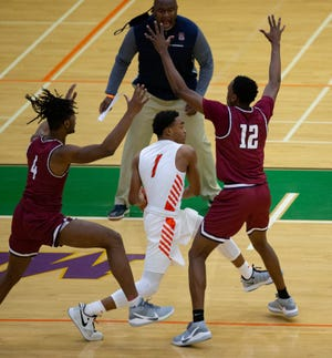 Florida A&M University guard Jalen Speer looks to pass during a game between FAMU and South Carolina State University at Alfred Lawson Jr. Multipurpose Center Sunday, Jan. 10, 2021.