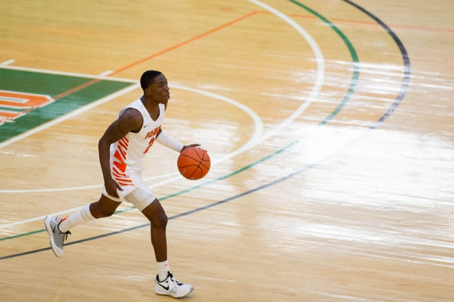 Florida A&M University guard Kamron Reaves dribbles up the court during a game between FAMU and South Carolina State University at Alfred Lawson Jr. Multipurpose Center Sunday, Jan. 10, 2021.