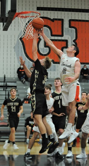 Ridgewood's Gabe Tingle blocks a shot by River View's Jordan Bryant in Saturday's game at Ridgewood. The Generals won 56-39.