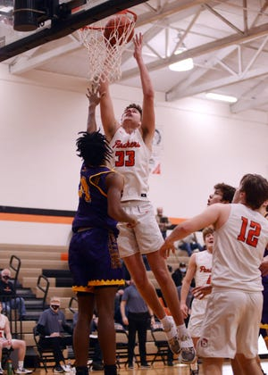 Braden Agriesti goes up for a shot in the lane over Bloom-Carroll's Da'Shan Clark in New Lexington's 41-29 win on Saturday.