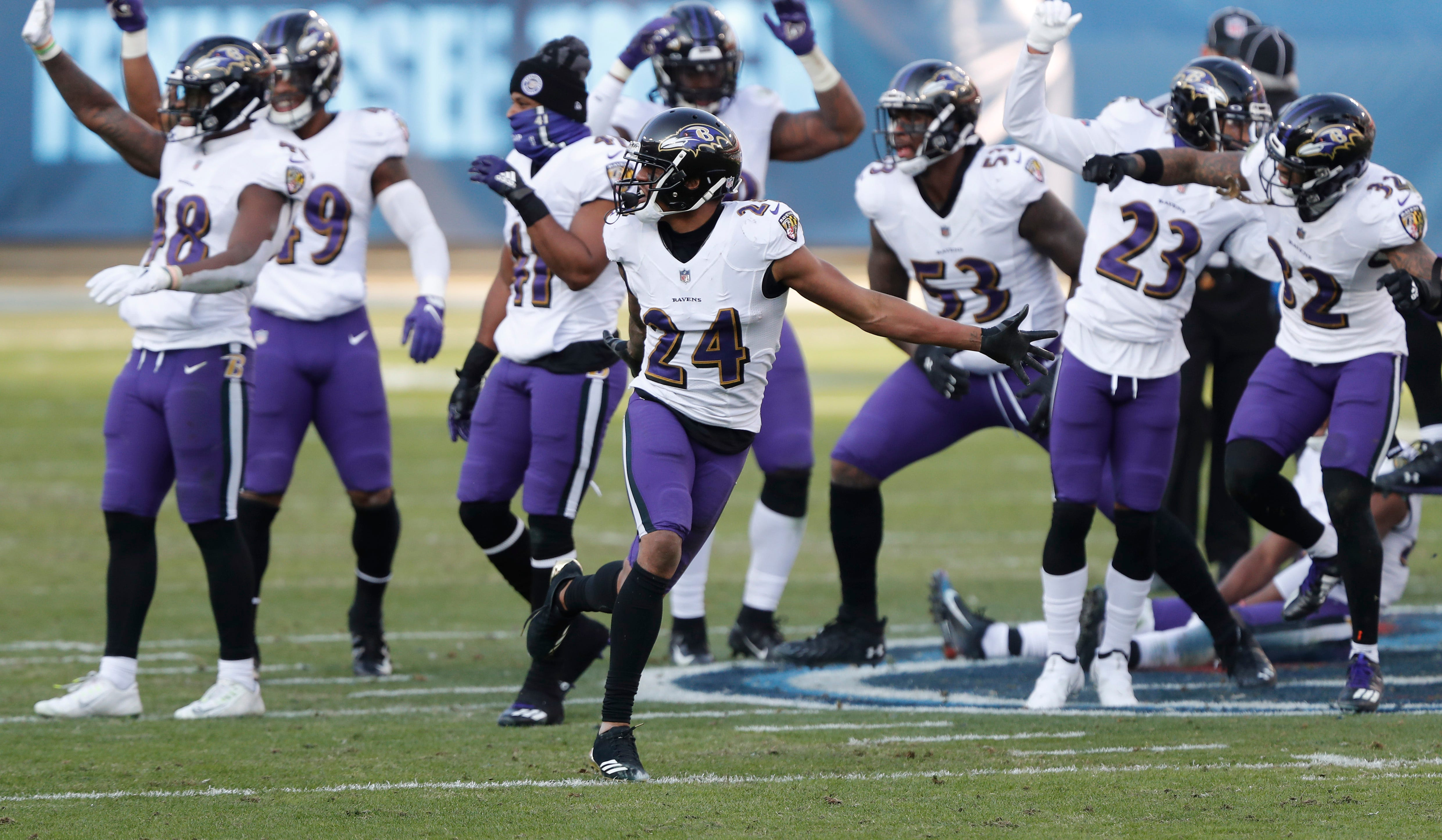 Ravens defense celebrates playoff win by dancing, stomping Titans logo
