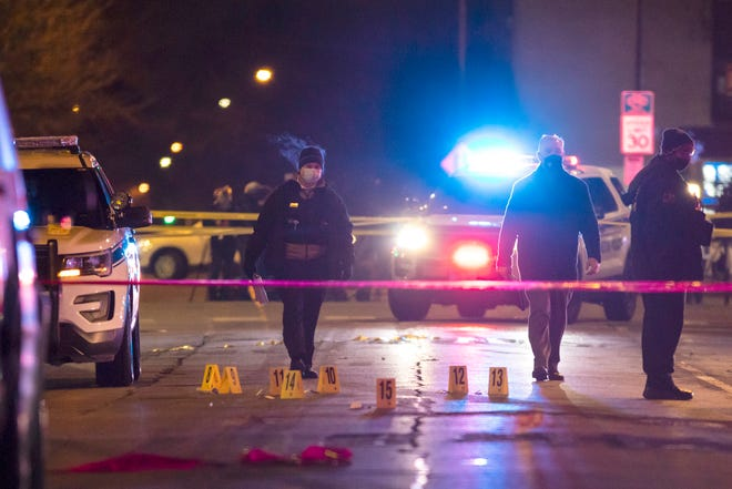 Chicago and Evanston police investigate a crime scene after a gunman went on a shooting spree before being killed by police during a shootout in Evanston, Ill., Saturday night, Jan. 9, 2021.