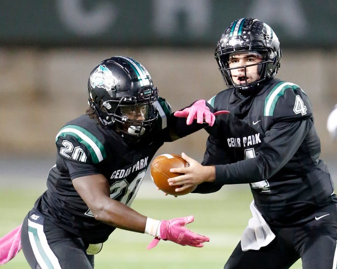 Cedar Park quarterback Ryder Hernandez, handing off to running back Kevin Adams, threw seven touchdown passes against Corpus Christi Veterans Memorial to help the Timberwolves reach the Class 5A Division I state championship game against Denton Ryan on Friday at AT&T Stadium in Arlington.