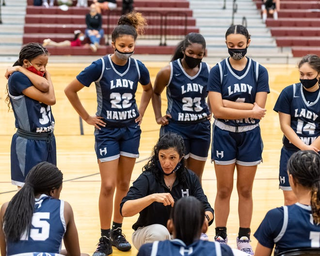 Hendrickson head coach Norma Sierra with her team during a timeout. Hendrickson won a non-district girls basketball game at Round Rock 67-48 on December 29, 2020. Henry Huey for American-Statesman.
