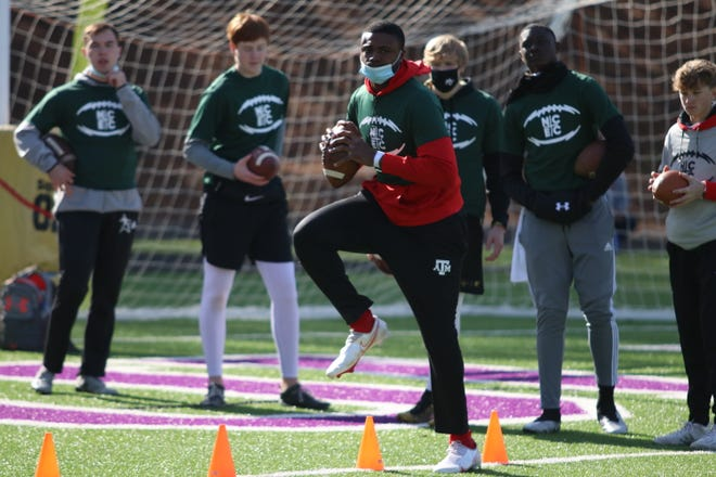 Four star quarterback Tevin Carter from Memphis, Tennessee works through a drill at Duluth High School on Sunday.