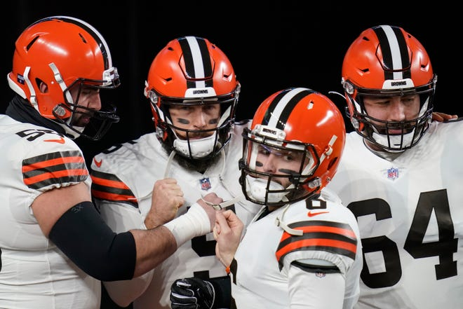 Cleveland Browns quarterback Baker Mayfield (6) takes the field for warm ups with center, Anthony Fabiano, left, quarterback Case Keenum (5), and center JC Tretter (64) before an NFL wild-card playoff football game, Sunday, Jan. 10, 2021, in Pittsburgh.