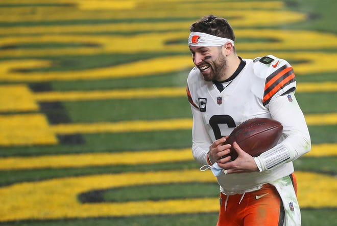 Browns quarterback Baker Mayfield (6) rushes back to the locker room after beating the Pittsburgh Steelers in an AFC wild-card playoff game. Mayfield's improvement as a player and leader this season have earned him a big payday from the Browns. [Jeff Lange/Beacon Journal]