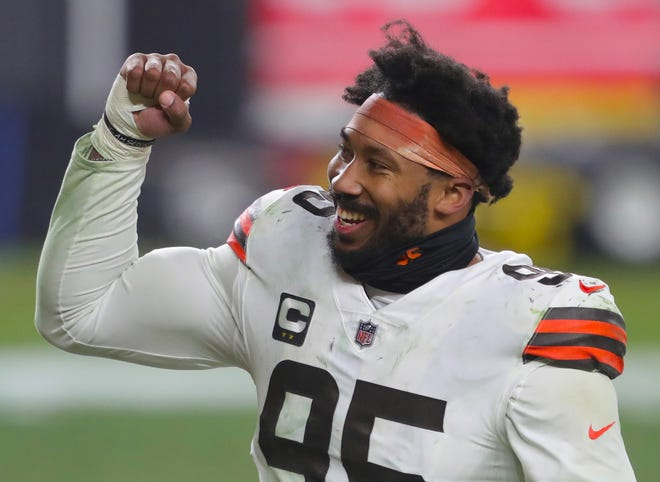 Cleveland Browns defensive end Myles Garrett (95) pumps his fist after beating the Pittsburgh Steelers in an NFL wild-card playoff football game, Sunday, Jan. 10, 2021, in Pittsburgh, Pennsylvania. [Jeff Lange/Beacon Journal]
