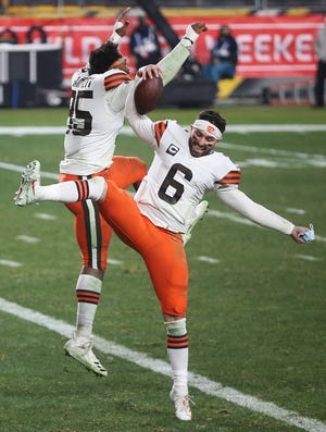 Cleveland Browns quarterback Baker Mayfield (6) celebrates with Cleveland Browns defensive end Myles Garrett (95) after beating the Pittsburgh Steelers 48-37 in an NFL wild-card playoff football game, Monday, Jan. 11, 2021, in Pittsburgh, Pennsylvania. [Jeff Lange/Beacon Journal]