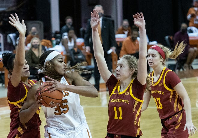 Texas junior Charli Collier (35) pulls down a rebound in front of Iowa State's Kristin Scott (25), Emily Ryan (11) and Maggie Espenmiller-McGraw (13) in Austin on Jan. 3, 2021. Texas was ranked 21st in the Associated Press' poll this week.