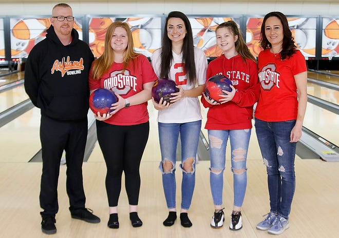 Ashland High girls bowling team members Makayla Dreibelbis, Kelsey Baker and Jada Baker pose with boys head bowling coach Mark Dreibelbis, far left, and girls head bowling coach Michele Baker, far right, at Luray Lanes on Jan. 11.