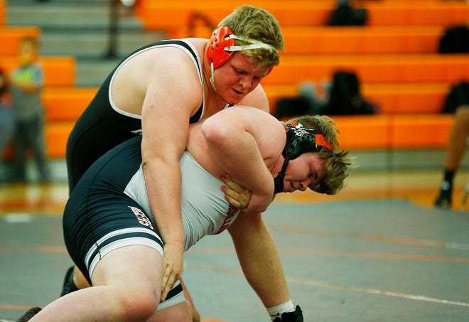 Ashland's Jake Bever tries to flip Massillon Washington's Rager Els during their heavyweight match on Jan. 7