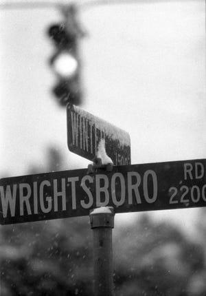 Ice coats Augusta street signs.