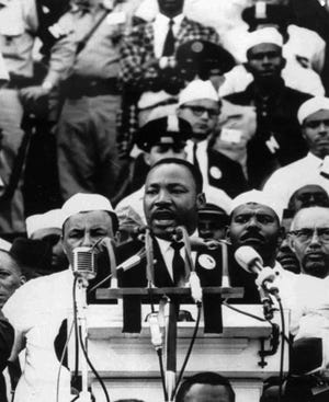 "In this Aug. 28, 1963 file photo, Dr. Martin Luther King Jr., head of the Southern Christian Leadership Conference, addresses marchers during his ""I Have a Dream"" speech at the Lincoln Memorial in Washington."