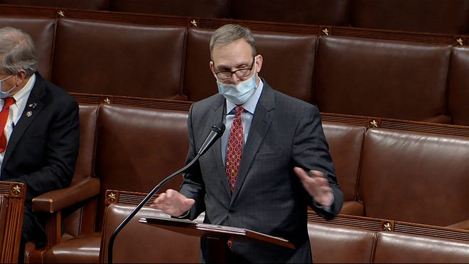 In this image from video, Rep. Scott Perry, R-Pa., speaks as the House debates the objection to confirming the Electoral College vote from Pennsylvania at the U.S. Capitol early Thursday, Jan. 7, 2021.
