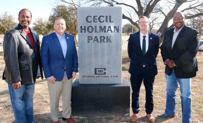 From left, Draco Miller, Brownwood mayor pro tem and Revitalizing Our Community (ROC) founder; Dr. Cory Hines, Howard Payne University president; Hunter Sims, HPU athletic director; and Harold Hogan, ROC board member are pictured earlier at the entrance to Cecil Holman Park.