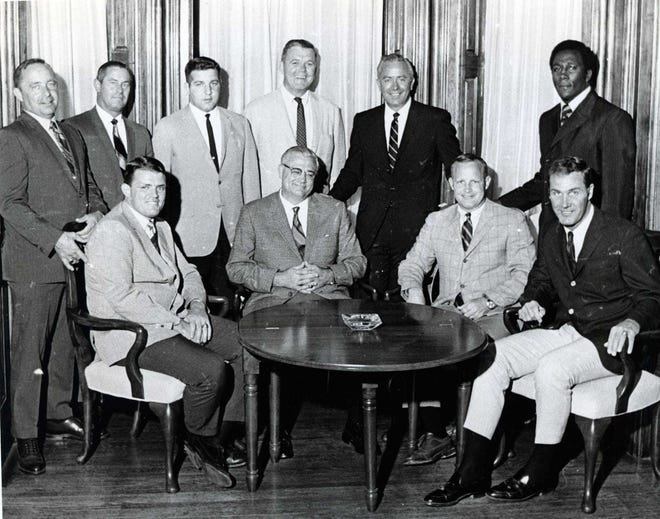 Rudy Hubbard, shown on Ohio State's coaching staff in 1969, was hired as the first minority assistant coach at OSU by coach Woody Hayes, seated with glasses. [Dispatch file photo]