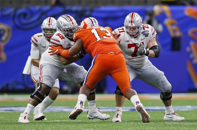 Ohio State right guard Wyatt Davis (52) almost certainly will leave for the NFL after the national championship game. Center Josh Myers (71) has not committed but is scheduled to play in the Senior Bowl.
