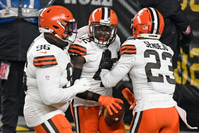 Browns safety Karl Joseph (42) celebrates his touchdown after recovering a wayward snap in the opening moments of Cleveland's whipping of Pittsburgh in an AFC wild-card playoff game.