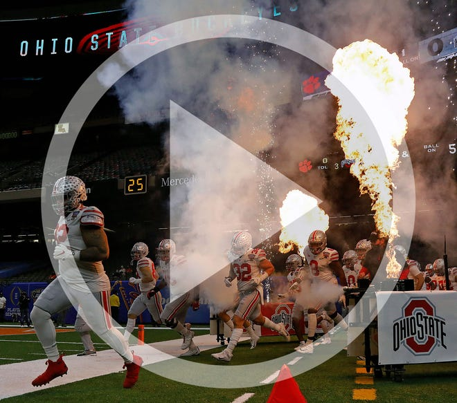 In this file photo, Ohio State Buckeyes take the field before the start of their game against Clemson Tigers in the College Football Playoff semifinal at the Allstate Sugar Bowl in the Mercedes-Benz Superdome in New Orleans on Friday, Jan. 1, 2021.