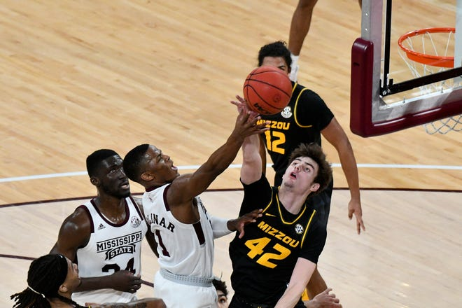 Mississippi State Bulldogs guard Iverson Molinar (1) goes up for a shot while defended by Missouri Tigers forward Parker Braun (42) at Humphrey Coliseum.