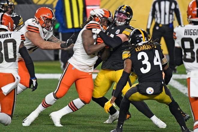 Cleveland Browns running back Kareem Hunt pushes his way into the end zone for an 11-yard touchdown against the Pittsburgh Steelers during the first half of an AFC wild-card playoff game on Jan. 10. (AP Photo/Don Wright)