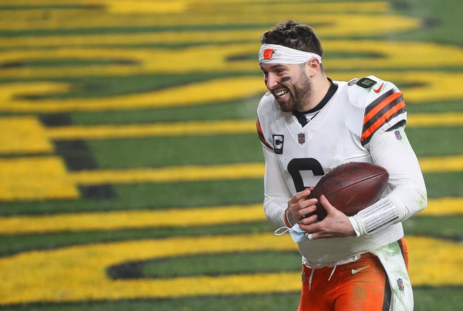 Quarterback Baker Mayfield (6) takes the ball with him as he leaves the field after leading the Browns to a playoff victory over the Pittsburgh Steelers. [Jeff Lange/Beacon Journal]