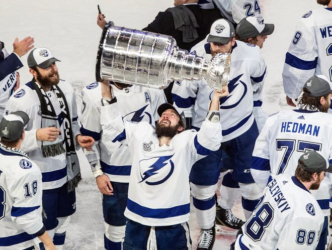 The Tampa Bay Lightning will be favored to win the NHL's new Central Division in 2021, but their bid to repeat as Stanley Cup champions may be complicated by the loss of star forward Nikita Kucherov, with the Cup, who will miss the regular season after hip surgery.
