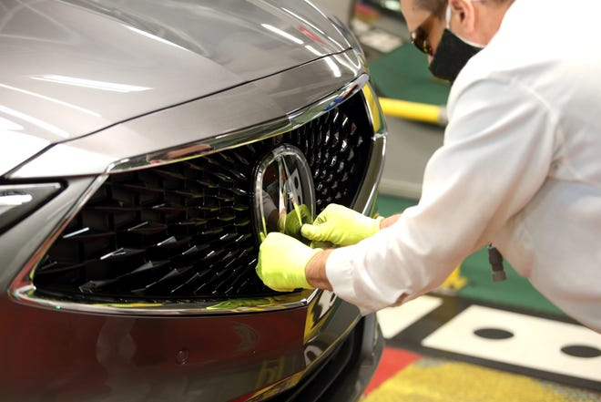 The Acura logo is installed on a completed 2022 Acura MDX at the East Liberty Auto Plant. The newly redesigned MDX started rolling off the line Tuesday.