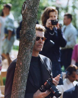 In this Daily Record file photo, David Bowie watches his son, Duncan Jones, graduate in the Oak Grove at the College of Wooster in 1995.